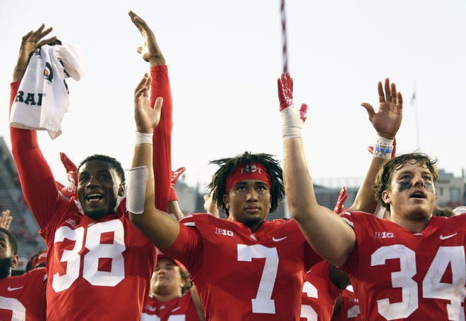 """Ohio State Buckeyes defensive back Cameron Kittle (38), Ohio State Buckeyes quarterback C.J. Stroud (7) and Ohio State Buckeyes tight end Mitch Rossi (34) sing """"Carmen Ohio"""" following Saturday's NCAA Division I football game against the Tulsa Golden Hurricanes at Ohio Stadium in Columbus on September 18, 2021. Ohio State won the game 41-20."""
