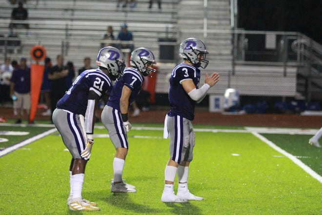 Dutchtown's backfield of Pierson Parent (No. 3), Dylan Sampson (No. 21) and Baylor Langlois (No. 7) piled up 371 rushing yards against Covington.