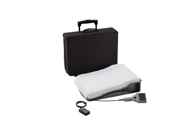 A portable electronics unit and a special pillow containing an antenna are used to take readings that are transmitted to the doctor.
