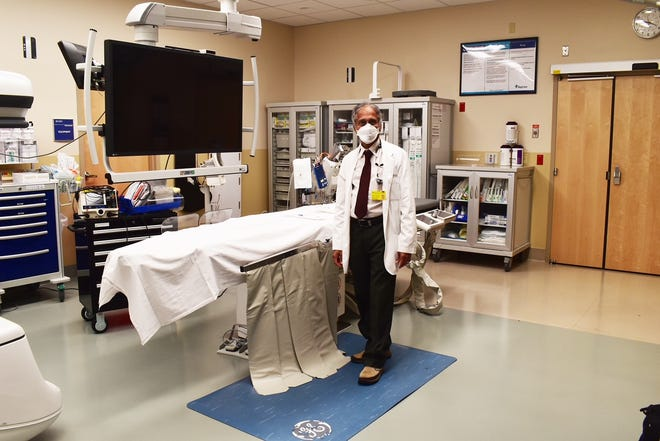 Cardiologist Dr. Kollagunta Chandrasekhar, a cardiologist who links some heart-failure patients to the Cardio-MEMS pulmonary monitoring system, in a cath lab at Winter Haven Hospital.