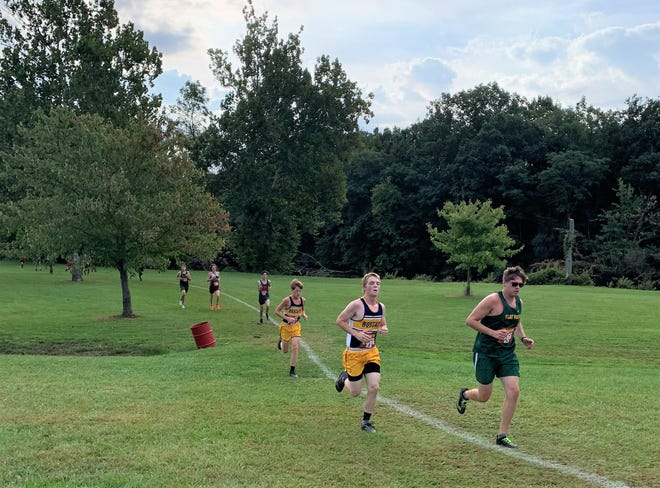 Monroe County Region runners race at the Huron Invitational on Saturday at Willow Metropark.