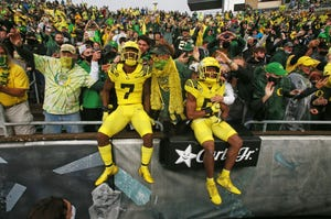 Oregon players jump into the stands with fans before the game vs. Stony Brook.