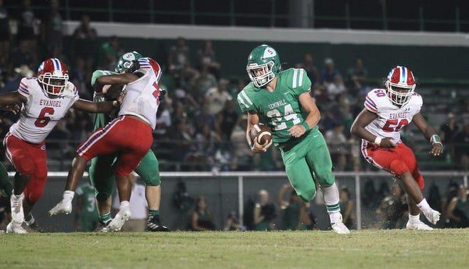 Seminole's Garrett Chaffin (24) tries to cut loose for a long gain against Evangel Christian Friday night.