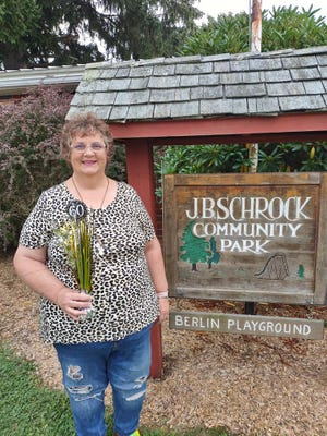 Linda Karchner, president of the J B Schrock Community Park Board, is celebrating her 60th birthday as a fundraiser for the playground.