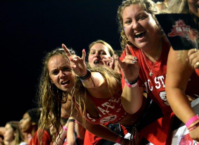 Sep 18, 2021; Raleigh, North Carolina, USA; North Carolina State Wolfpack fans cheer during the first half at Carter-Finley Stadium.