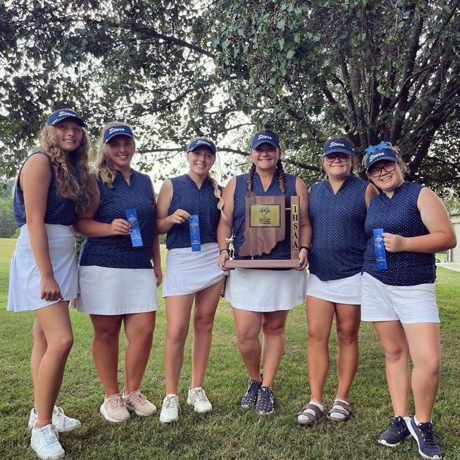 BNL girls golfer (left to right) Sam Biel, Kenley Craig, Chloe McFaddin, coach Kori Johnston, Ellie Horton and Daphney Sproles gather around the sectional championship trophy they won Saturday at Otis Park.