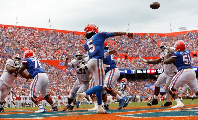 Florida quarterback Emory Jones throws from the end zone Saturday, as he leads a 99 yard drive against Alabama at Ben Hill Griffin Stadium.