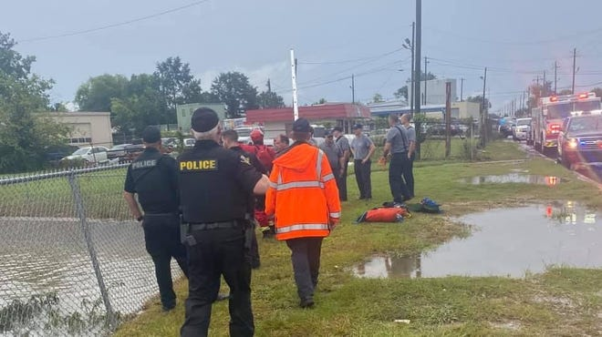 Tuscaloosa police officers and the Tuscaloosa Fire Rescue's Swift Water Team worked Saturday afternoon to locate a motorist whose vehicle had been swept away in floodwaters in the 2400 block of Greensboro Avenue.