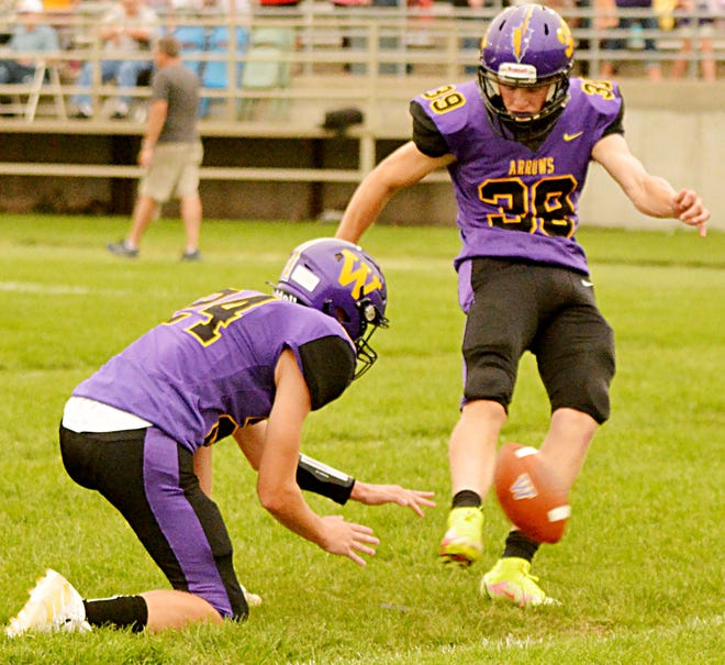 Watertown High School kicker Andrew Czech (right) makes a kick off the hold from teammate Kohen Kranz during pre-game warmups recently before a game against Brookings. On Friday, Czech's 23-yard field goal in the final second of the game lifted the Arrows to a 24-22 win at Huron.