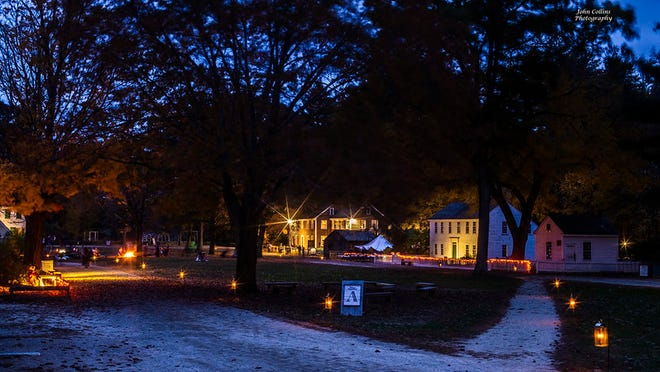 """During the """"Phantoms and Fire"""" event at Old Sturbridge Village, lights will guide the way for visitors as night falls."""