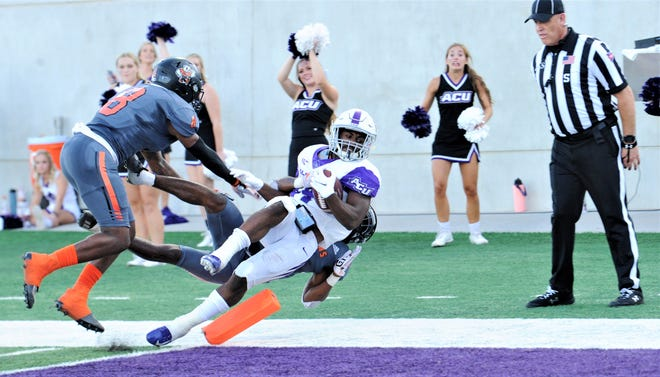 ACU's Tyrese White lunges into the end zone for a 40-yard TD run as the UTPB defense gives chase. White's TD snapped a 3-3 tie with 4:07 left in the first half. ACU beat the Falcons 34-9 in the nonconference game Saturday, Sept. 18, 2021 at Wildcat Stadium.