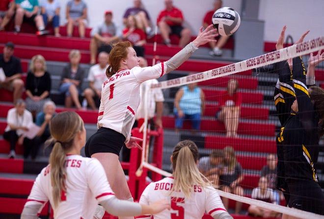 Buckeye Central's Mia McDougal pushes a ball over the Monroeville defense.
