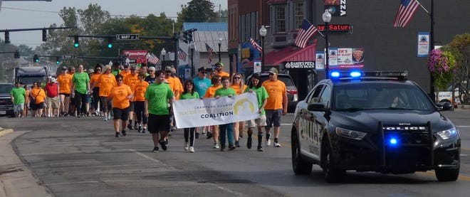 Participants head down Sandusky Avenue Saturday morning in the annual Walk for Suicide Prevention. Walkers also participated in Galion and Crestline.