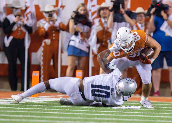 Sep 18, 2021; Austin, Texas, USA; Texas Longhorns tight end Cade Brewer (80) is tackled by Rice Owls defensive back Kenneth Orji (10) during the second quarter at Darrell K Royal-Texas Memorial Stadium. Mandatory Credit: John Gutierrez-USA TODAY Sports