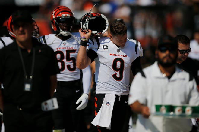 Cincinnati Bengals quarterback Joe Burrow (9) returns to the sideline after throwing his second interception in as many possessions in the fourth quarter of the NFL Week 2 game between the Chicago Bears and the Cincinnati Bengals at Soldier Field in Chicago on Sunday, Sept. 19, 2021. The Bears held on to a halftime lead for a 20-17 win over the Bengals.