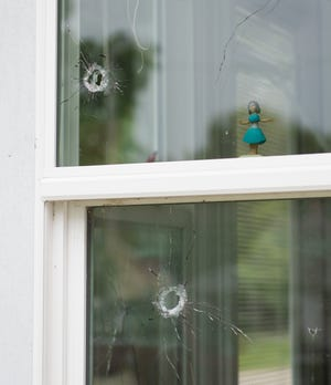 Bullet holes litter the house at 612 Short St. in New Harmony, Ind., Sunday afternoon, Sept. 19, 2021. The officer-involved shooting at the house Saturday night left Posey County Sheriff's Deputy Bryan Hicks in critical but stable condition.