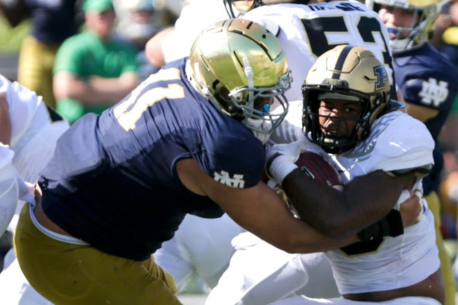 Purdue linebacker Jaylan Alexander (36) blocks Notre Dame defensive lineman Kurt Hinish (41) during the second quarter of an NCAA college football game, Saturday, Sept. 18, 2021 at Notre Dame Stadium in South Bend.