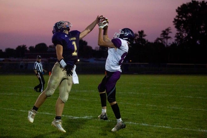 Millersport's Trey Johnston (1) tries to knock down a pass against a Miller receiver during their game last Saturday night. It was the first time the Lakers have played a home game since 2017.