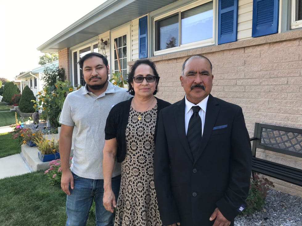 Maria Espino, center, with her husband, Lazaro Sr., right, and son Lazaro Jr., at their home in the College Heights neighborhood on Milwaukee's far south side.