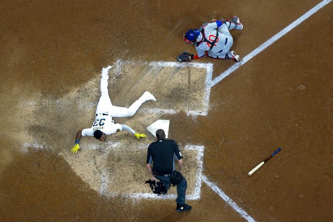 Milwaukee Brewers' Pablo Reyes scores safely past Chicago Cubs catcher Willson Contreras during the eighth inning of a baseball game Saturday, Sept. 18, 2021, in Milwaukee. Reyes scored on a hit by Kolten Wong. (AP Photo/Morry Gash) ORG XMIT: WIMG127