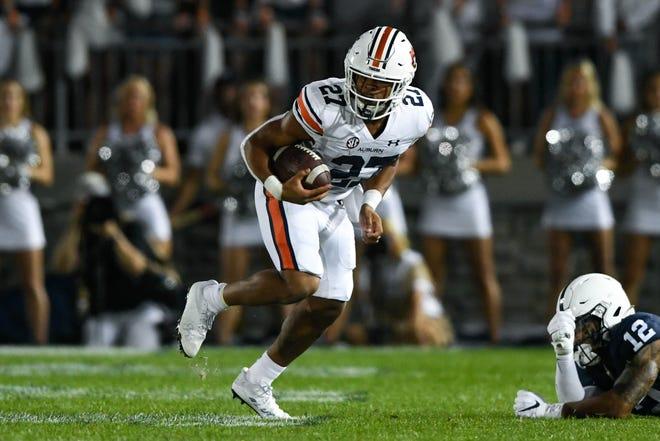 Sep 18, 2021; University Park, PA, USA; Jarquez Hunter (27) running the ball between Auburn and Penn State at Beaver Stadium. Mandatory Credit: Todd Van Emst/AU Athletics