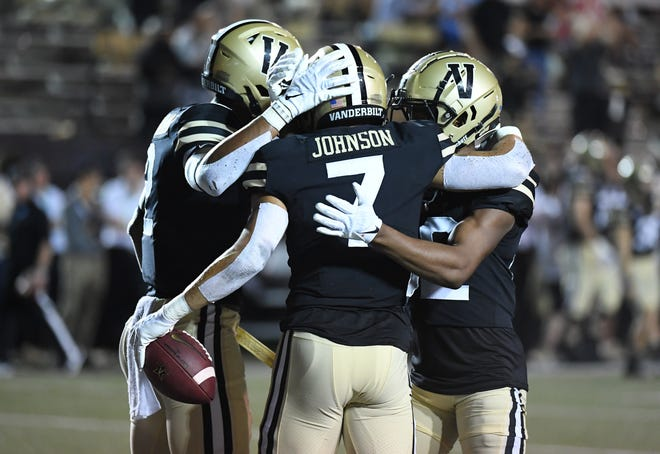 Sep 18, 2021; Nashville, Tennessee, USA; Vanderbilt Commodores wide receiver Cam Johnson (7) celebrates after a late touchdown during the second half against the Stanford Cardinal at Vanderbilt Stadium. Mandatory Credit: Christopher Hanewinckel-USA TODAY Sports