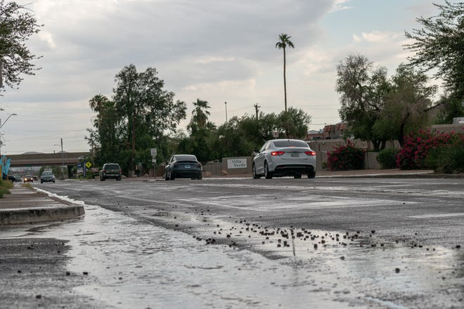 People are faced with wet roads in Phoenix on Saturday, Sept. 18, 2021.
