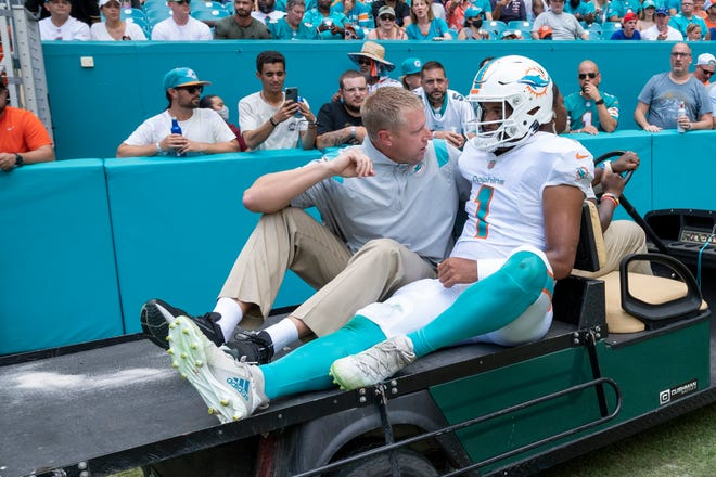 Miami Dolphins quarterback Tua Tagovailoa (1) is carted off the field with a rib injury during an NFL football game against the Buffalo Bills, Sunday, Sept. 19, 2021, in Miami Gardens, Fla. (AP Photo/Doug Murray)