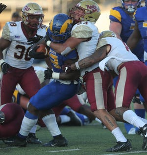Angelo State University running back Nathaniel Omayebu is bottled up by Midwestern State during a Lone Star Conference game at LeGrand Stadium at 1st Community Credit Union Field on Saturday, Sept. 18, 2021.