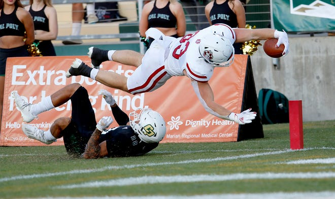 South Dakota's Austin Goehring (83) gets a touchdown over a Cal Poly defender during an NCAA college football game in San Luis Obispo, Calif., Saturday, Sept. 18, 2021. (Laura Dickinson/The Tribune (of San Luis Obispo) via AP)