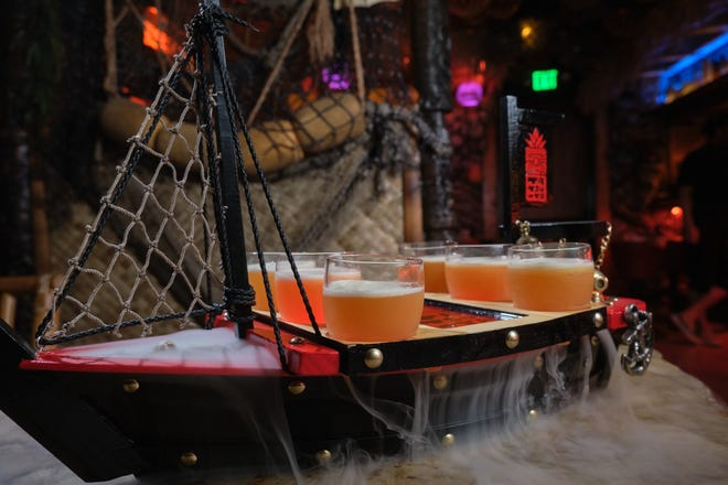 Large format drinks and the Banzai!! Boat loaded with shot glasses arrive at tables at Tiki Tatsu-Ya in dramatic fashion.