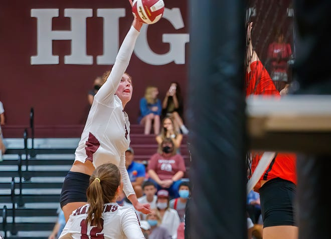 Austin High's Sadie Swift taps the ball over the net in the Maroons' win over Lake Travis last week. Swift hadeight blocks and six kills against Lake Travis to control the net and recorded another six kills and two blocks vs. Del Valle as the Maroons stayed perfect in district play.