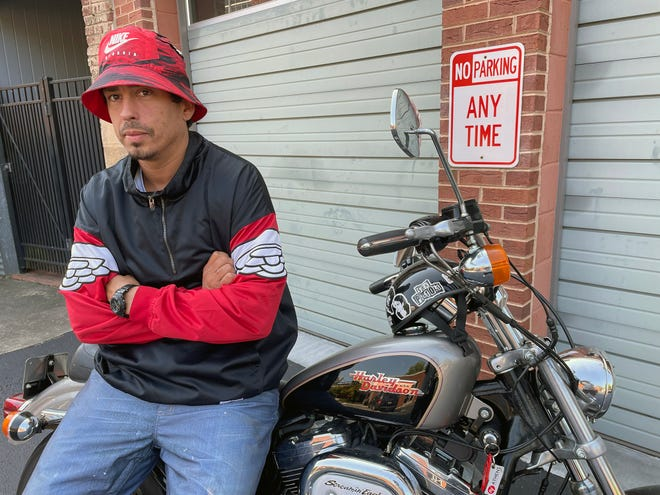 Athens singer-songwriter Cortez Garza sits on his motorcycle in the Bottleworks parking lot on Sept. 13, 2021. Garza's debut hip-hop album, released under the stage name Niño Brown, is expected to come out in 2022.