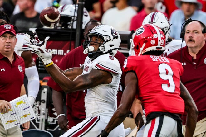 South Carolina wide receiver Josh Vann (6) catches a pass over Georgia defensive back Ameer Speed (9) for a first down during the first half of a college football game Saturday, Sept. 18, 2021, in Athens, Ga. (AP Photo/Butch Dill)
