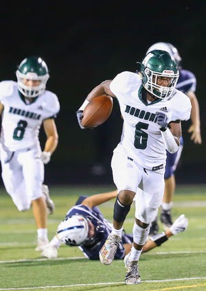 Nordonia wide receiver Jon Henderson breaks into the clear during the Knights' 57-7 win at Twinsburg Friday.