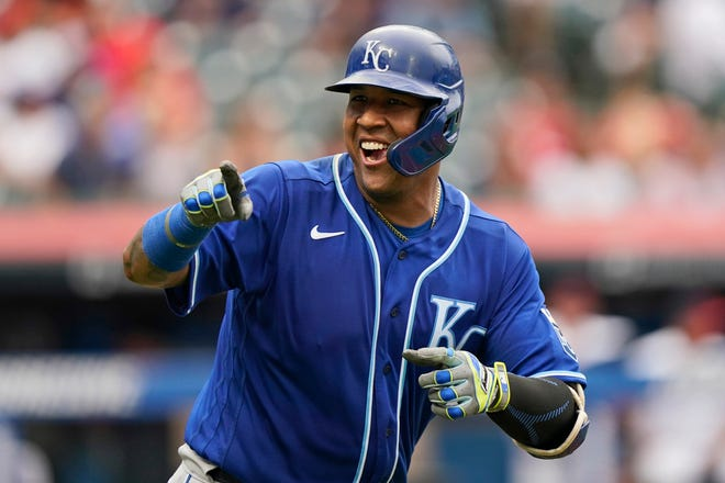 Kansas City Royals' Salvador Perez smiles and points to the dugout after hitting a two-run home run in the fifth inning in the first baseball game of a doubleheader against Cleveland, Monday, Sept. 20, 2021, in Cleveland. The home run broke Johnny Bench's record for the most home runs in a season by a primary catcher. (AP Photo/Tony Dejak)