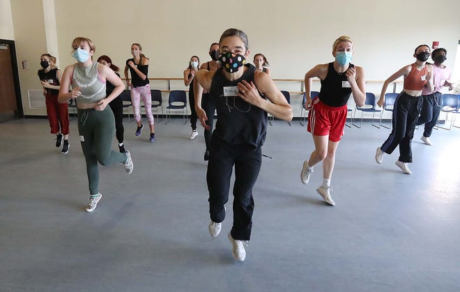 """Monica Bill Barnes, founder of a dance company in New York, teaches a routine Monday to University of Akron students. They were auditioning to be cast in """"The Running Show"""" at E.J. Thomas Hall on Saturday."""