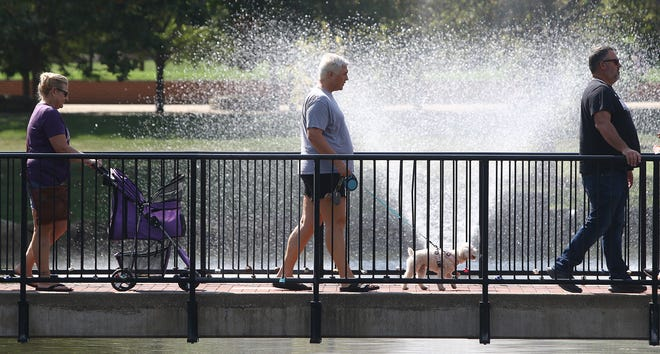 Visitors to the many events on Mount Union's campus Saturday, Sept. 18, 2021, make their way over a foot bridge. On campus Saturday were ArtFest and a Food Truck Rally.
