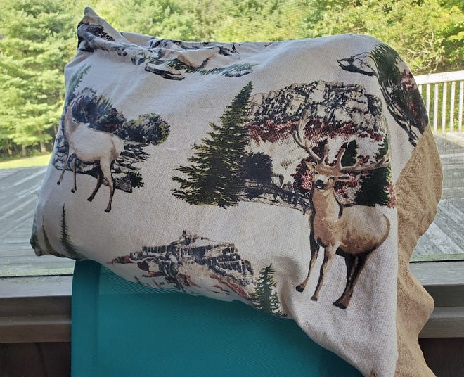 With my elk-themed print pillowcase, I don't need a gun to make me feel safe in my tent.