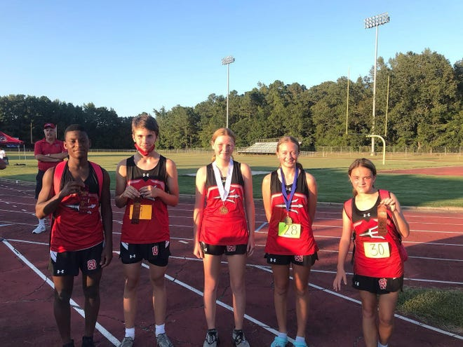 WHHS Cross Country winners from left: David Cox- 5th place, David Crosby- 8th place, Megan Tymeson – 3rd Place, Taryn Hanna - 1st place, Alexis Nix- 8th place.