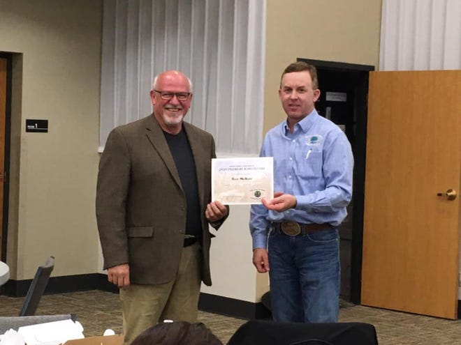 """Rick McNary, Potwin, left, received the Friend of Agriculture Award from the  Butler County Farm Bureau during the organization's 2019-2020 Annual Meeting. This week he is being recognized again for his """"Shop Kansas Farms"""" effort, this time at the state level by the Huck Boyd Institute."""