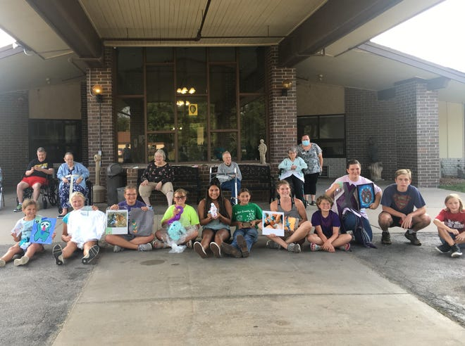 North Butler 4-H'ers meet outside with Wheat State Manor residents to show their projects