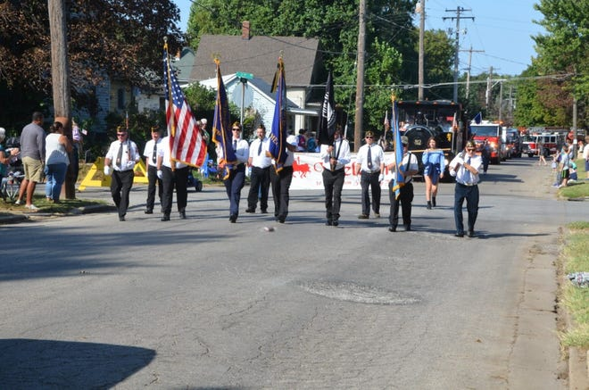 Pictured are members of the Canton American Legion & Canton VFW guard with the 40/8 train close behind them.