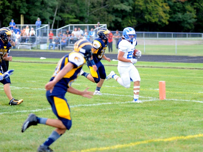 Inland Lakes' Payton Teuthorn, right, wins the sprint to the endzone for the Bulldogs' second touchdown of the night during Friday's win at Alcona.