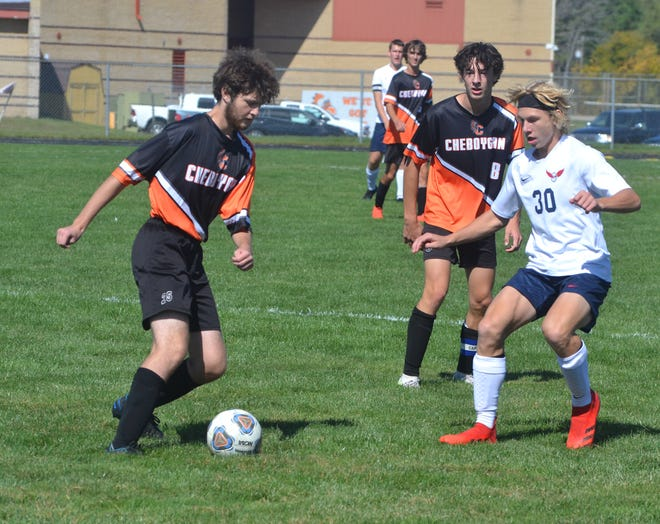 Cheboygan senior Logan Smith, left, scored a goal in Saturday's matchup against Boyne City, but the Ramblers captured a 5-1 victory on the road.
