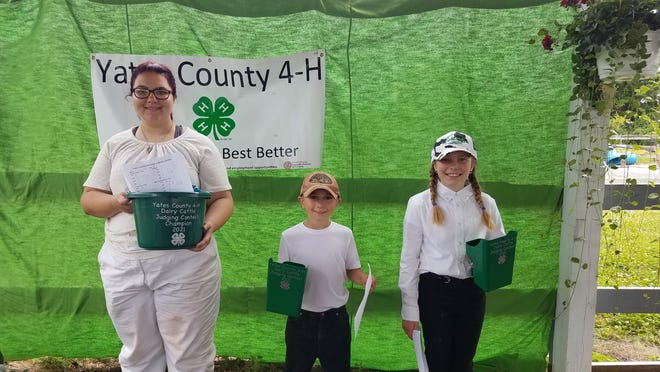 Ginny Savage, Jacob Martens, and Leila Martens – 4-H Dairy Judging Contest participants.