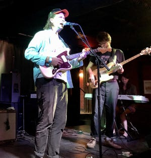 Frontman John Ross, of the Brooklyn-based band Wild Pink, performs at the Rumba Cafe on Sunday.