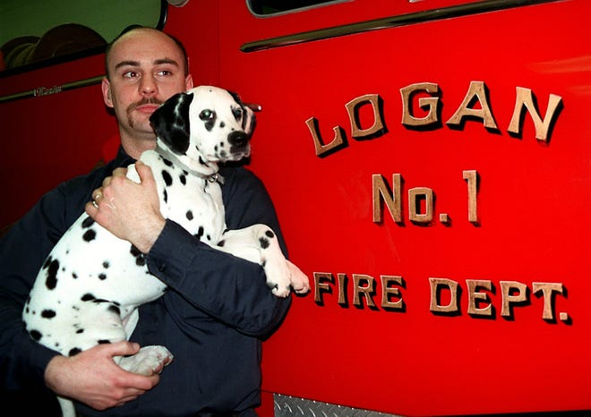 Firefighter Dan Libby and Butterscotch. The dalmation puppy was the pride and joy of Glen Miller Jr., 6, who died of leukemia.