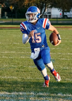 Lenawee Christian's Ashur Bryja runs the ball during a game against North Adams Jerome on Sept. 10.