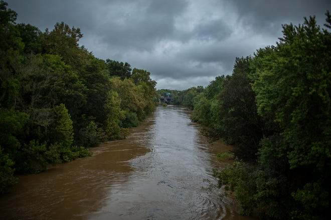 The waters of the Duck River rise under the East 5th Street Bridge in Columbia, Tenn., following a weekend of extensive rainfall on Monday, Sept. 20, 2021.